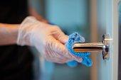 Disinfecting a door knob