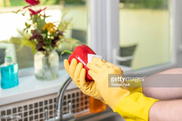 disinfecting a red bell pepper to protect against virus - obsessive compulsive disorder stock pictures, royalty-free photos & images