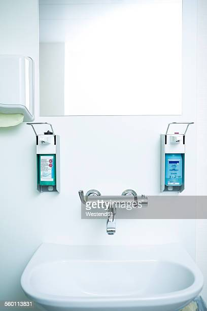 disinfecting and soap dispenser at sink - hygiene stock-fotos und bilder