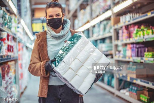 disinfecting groceries during covid-19 - buying toilet paper stock pictures, royalty-free photos & images