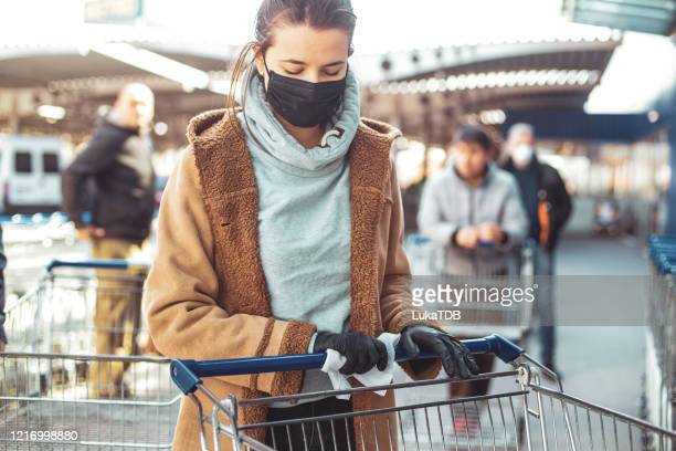 disinfecting groceries during covid-19 - illness prevention stock pictures, royalty-free photos & images