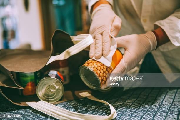 disinfecting groceries - avoidance stock pictures, royalty-free photos & images