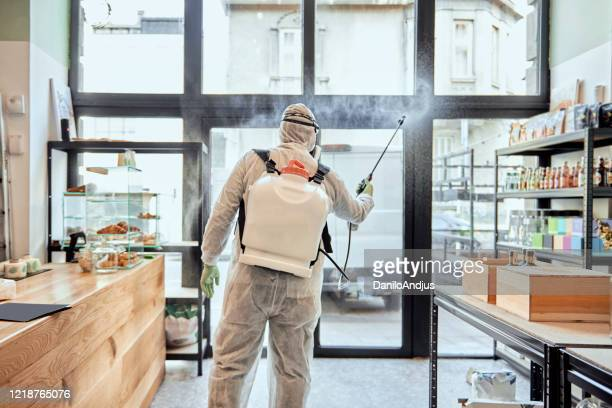 disinfecting workplace ,taking measures against the global pandemic - disinfection stock pictures, royalty-free photos & images