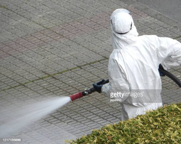 disinfection staff of public spaces - industrial hose stock pictures, royalty-free photos & images