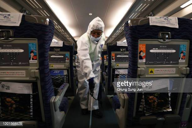 A disinfection worker wearing protective gears spray antiseptic solution in an train amid rising public concerns over the spread of China's Wuhan...