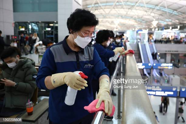 Disinfection workers wearing masks and spray anti-septic solution at the Incheon International Airport on January 27, 2020 in Incheon, South Korea....