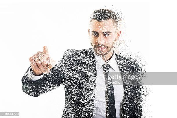 disintegrated business man pushing a button - disintegration stock photos and pictures
