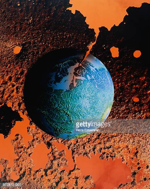 'disintegrating globe', composite of model globe and lunar background - disintegration stock photos and pictures