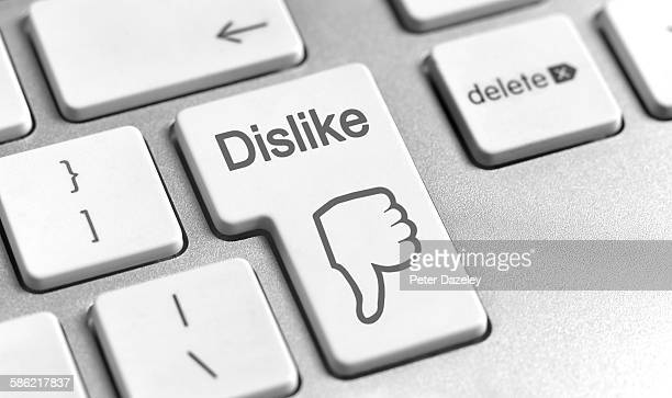 dislike computer key - online bullying stock pictures, royalty-free photos & images