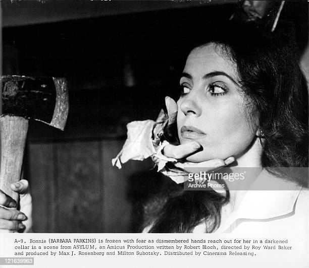 Dismembered hand reaches out to Barbara Parkins in a scene from the film 'Asylum' 1972