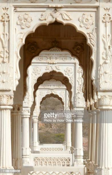 disminishing perspective through the arches of the white marble carved gazebos of the jaswan thada cenotaph complex in jodhpur, rajasthan, india - the cenotaph stock pictures, royalty-free photos & images