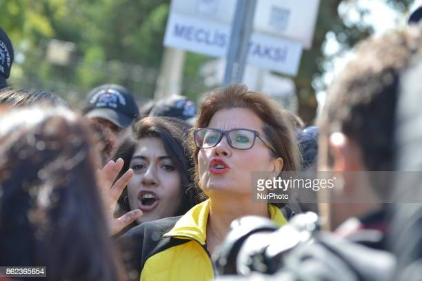Dismissed academic Nejla Kurul chants slogans as Turkish riot policemen disperse woman protesters who were going to march to the Grand National...