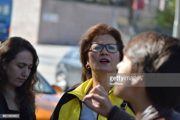 Dismissed academic Nejla Kurul looks on as Turkish riot policemen disperse woman protesters who were going to march to the Grand National Assembly of...