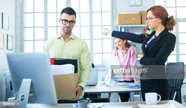 dismissed employee - being fired stock photos and pictures