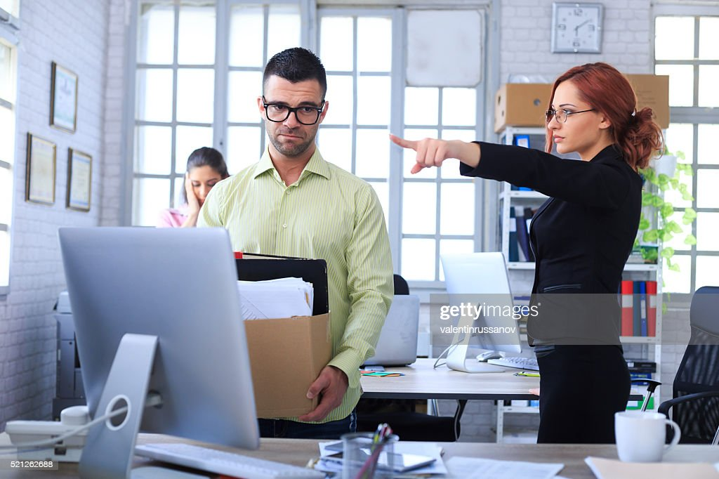 Dismissed man leaving the office : Stock Photo