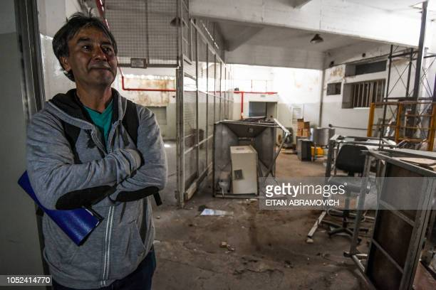 A dismissed worker of the Roux Ocefa Laboratory is seen at the company's facilities in Buenos Aires on October 09 2018 A laboratory a textile and a...