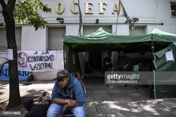Dismissed workers of the Roux Ocefa Laboratory camp outside the company's facilities in Buenos Aires on October 09 2018 A laboratory a textile and a...