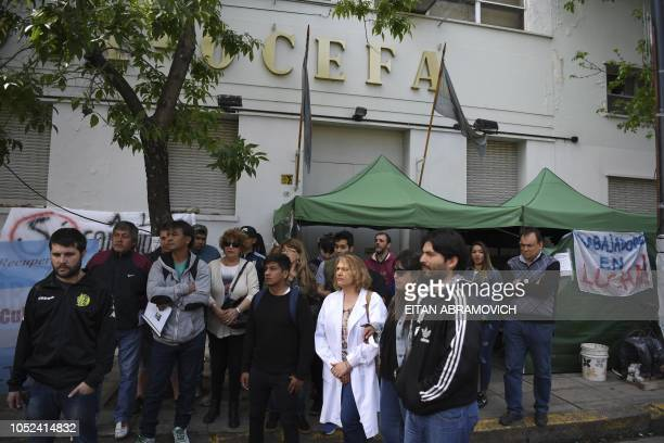 Dismissed workers of the Roux Ocefa Laboratory gather outside the company's facilities in Buenos Aires on October 09 2018 A laboratory a textile and...
