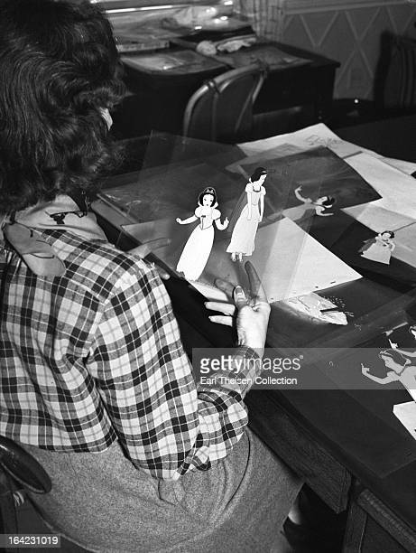 Disney animator works on cells from the film 'Snow White' circa 1936 in Los Angeles California