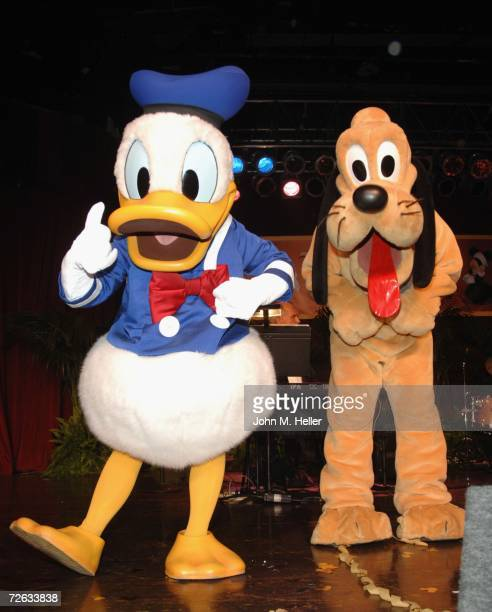 Disney cartoon characters Donald Duck and Pluto perform at the Salvation Army's California Division Thanksgiving Eve Dinner sponsored by the Walt...