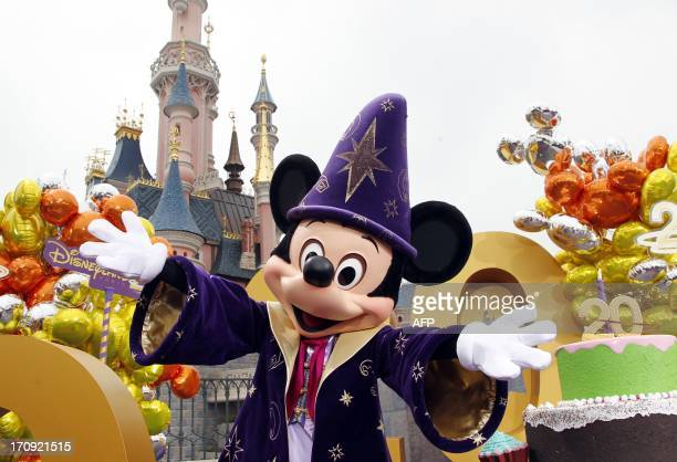 Disney character Mickey gestures as he poses during the launch of Disneyland Paris's 20th birthday celebrations at Disneyland Park in Chessy near...