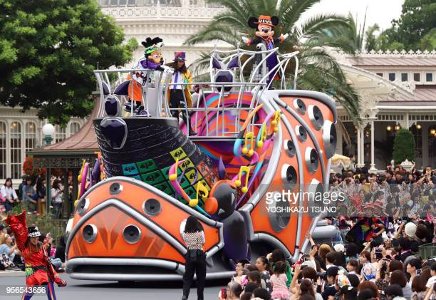 Disney character Mickey Mouse greets guests from a float during the preview of the Halloween parade at Tokyo Disneyland in Urayasu, suburban Tokyo on...