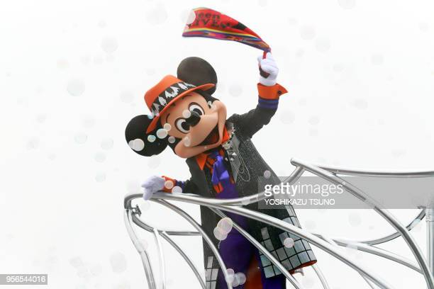 Disney character Mickey Mouse greets guests from a float during the preview of the Halloween parade at Tokyo Disneyland in Urayasu suburban Tokyo on...