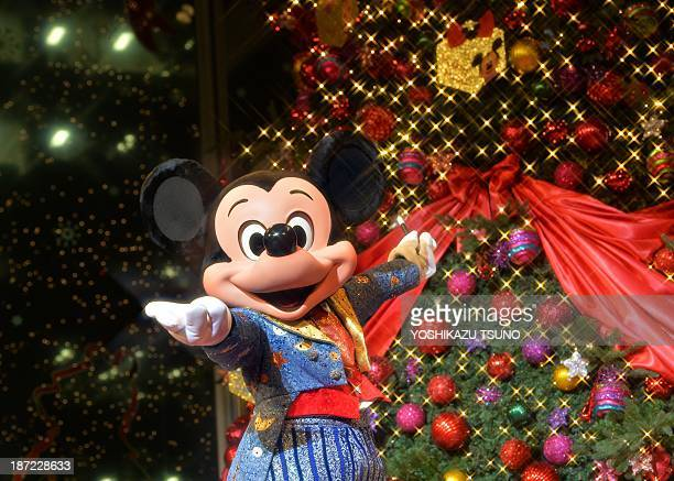 Disney character Mickey Mouse lights illuminations of an eightmeter tall Christmas tree at the lighting ceremony at the Marunouchi building in Tokyo...
