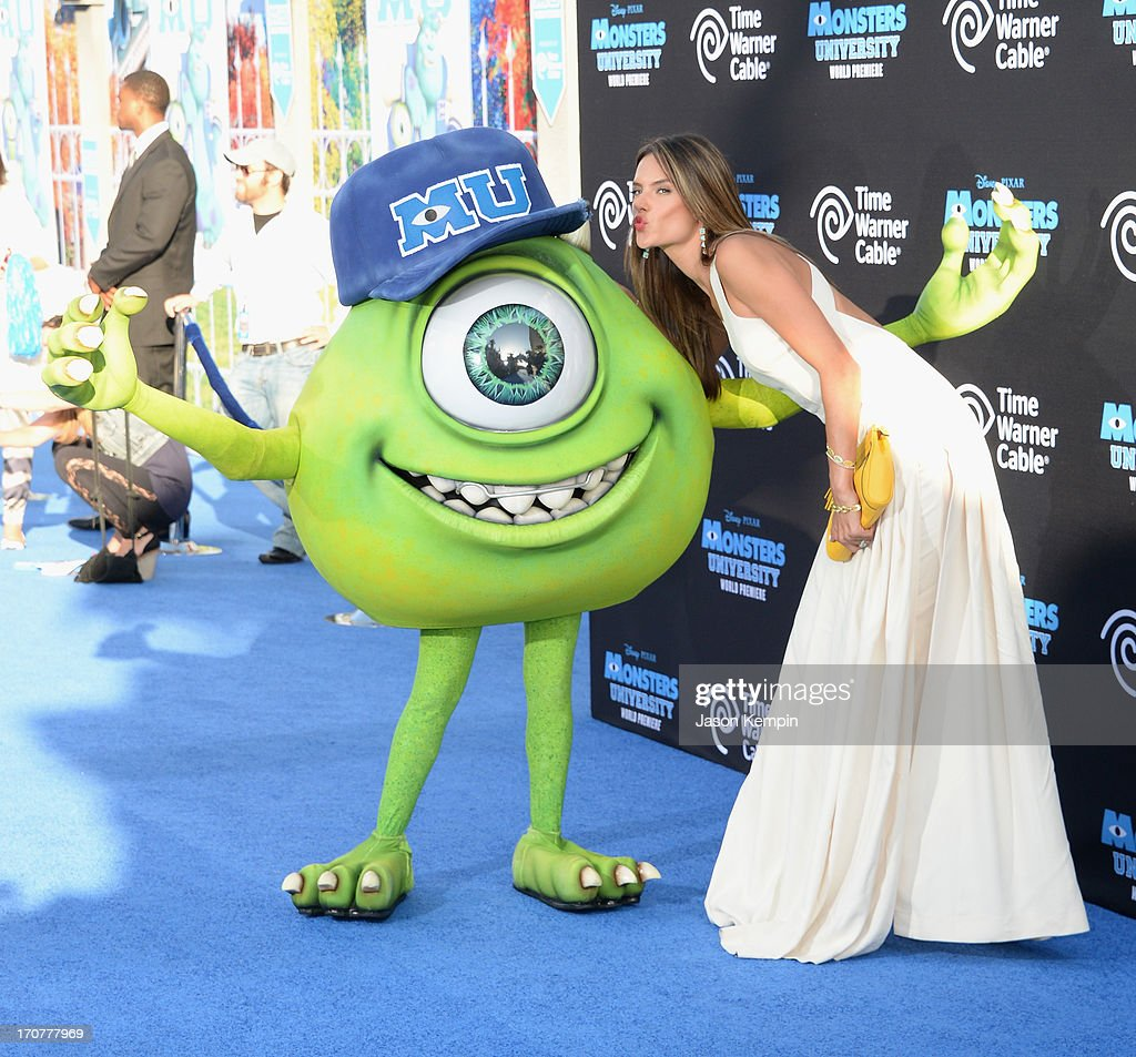 Disney character Mike Wazowski and model Alessandra Ambrosio attend the premiere of Disney Pixar's 'Monsters University' at the El Capitan Theatre on June 17, 2013 in Hollywood, California.