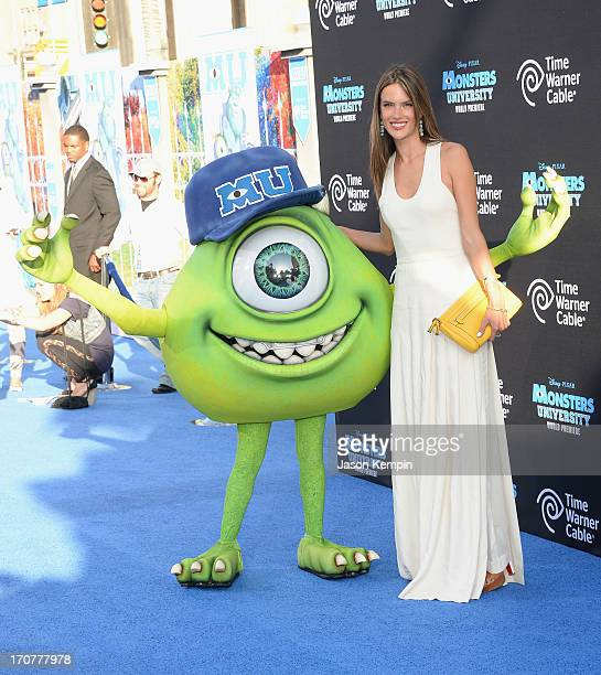 Disney character Mike Wazowski and model Alessandra Ambrosio attend the premiere of Disney Pixar's Monsters University at the El Capitan Theatre on...