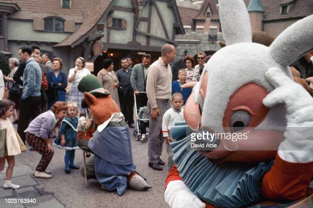 Disney characters entertain children in the Fantasyland area of Disneyland in1963 in Anaheim California