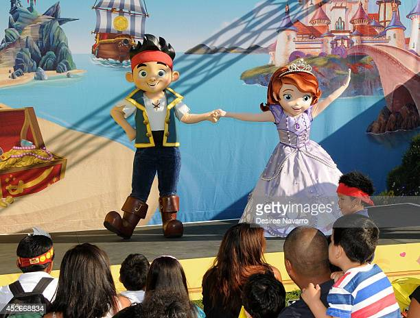 Disney characters 'Jake and the Neverland Pirates' and 'Sofia the First' dance on stage during the Pirate and Princess Power of Doing Good Tour at...
