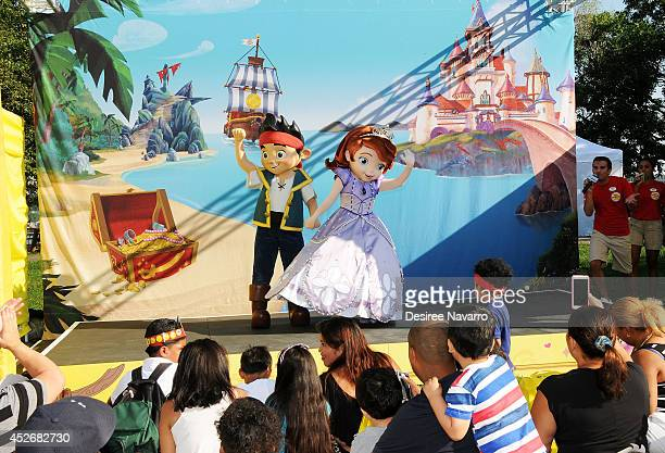 Disney characters 'Jake and the Neverland Pirates' and 'Sofia the First' perform on stage during the Pirate and Princess Power of Doing Good Tour at...