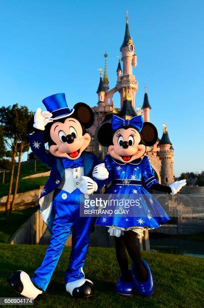 Disney characters Mickey and Mini mouse pose in front of the Sleeping Beauty Castle to mark the 25th anniversary of Disneyland originally Euro Disney...