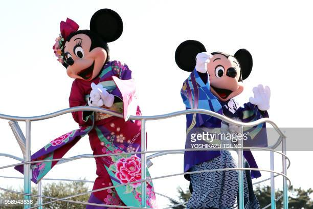 Disney characters Mickey and Minnie Mouse, dressed in traditional Japanese kimonos, wave to greet guests from a float during the theme park's annual...