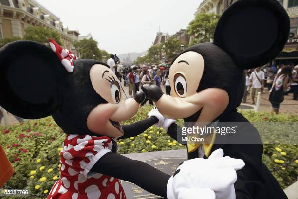 Disney characters Mickey and Minnie Mouse welcome visitors during the grand opening day of Hong Kong Disneyland September 12, 2005 in Hong Kong