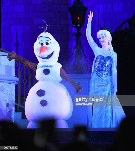 Disney characters of animation movie Frozen Olaf and Queen Elsa perform 'A Frozen Holiday Wish' during the 'Mickey's Very Merry Christmas Party' at...