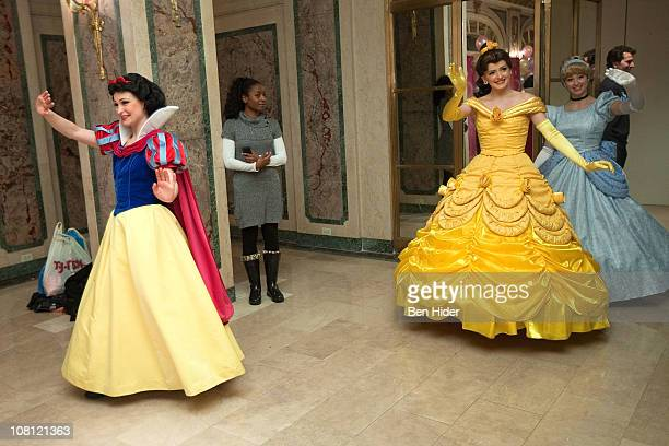 Disney characters Snow White Belle and Cinderella attend a tea party at The Plaza Hotel on January 18 2011 in New York City