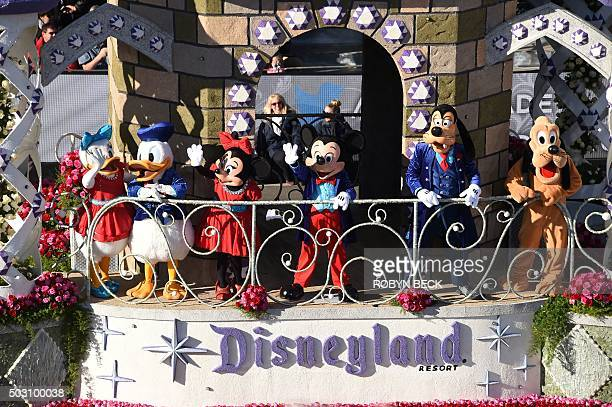 Disney characters wave from Disneyland Resort's Diamond Celebration float celebrating the park's 60th anniversary in the 127th Rose Parade in...
