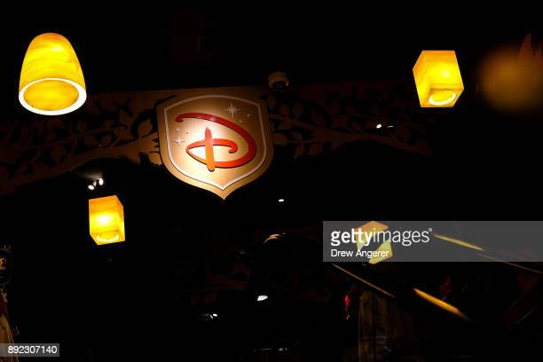 Disney logo is displayed inside the Disney Store in Times Square December 14 2017 in New York City The Walt Disney Company announced on Thursday...