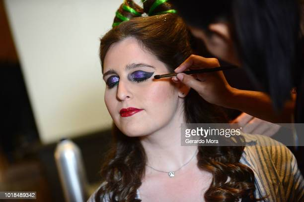 Disney model wears a Maleficent make up during the Mickey's NotSoScary Halloween Party at Magic Kingdom on August 17 2018 in Lake Buena Vista Florida
