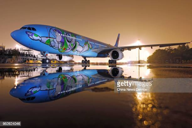 Disney Pixar Toy Storythemed aircraft launched by China Eastern Airlines is seen before its maiden flight from Shanghai Hongqiao International...