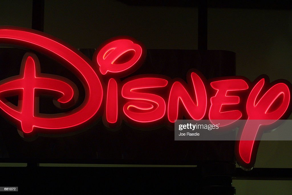 A Disney sign glows at Walt Disney World's Epcot Center November 11, 2001 in Orlando, Florida.