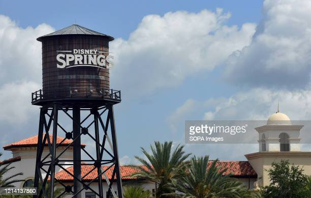 Disney Springs sign at Walt Disney World is seen a day before the retail dining and entertainment complex begins a phased reopening following the...