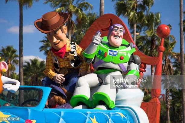 disney stars and motor car parade, buzz lightyear and woody, disney mgm studios, orlando, florida, usa - disney world stock pictures, royalty-free photos & images