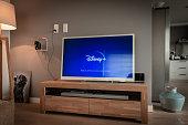 Disney+ startscreen on tv. Disney+ online video, content streaming subscription service. Disney plus, Star wars, Marvel, Pixar, National Geographic.