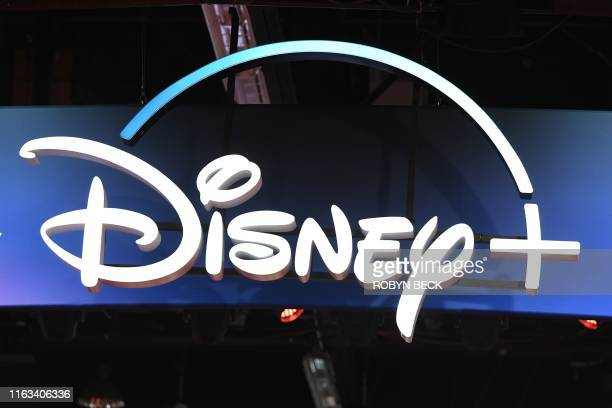 "Disney+ streaming service sign is pictured at the D23 Expo, billed as the ""largest Disney fan event in the world,"" on August 23, 2019 at the Anaheim..."