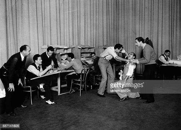 Disney Walt Film producer Businessman USA Disney with his employees in a motion study for drawn by a Mickey Mouse Scene around 1938 Published by...