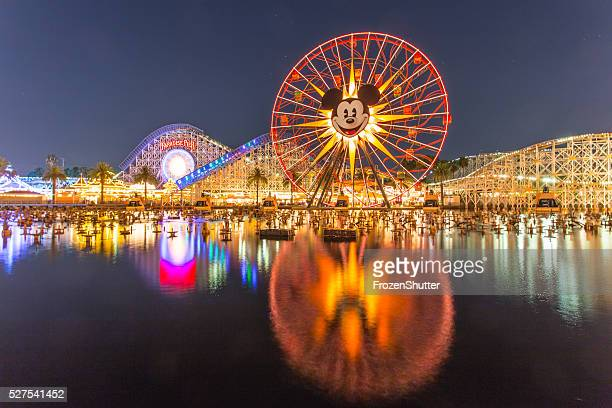disneyland 60th aniversary at cars land night time - disney stock pictures, royalty-free photos & images