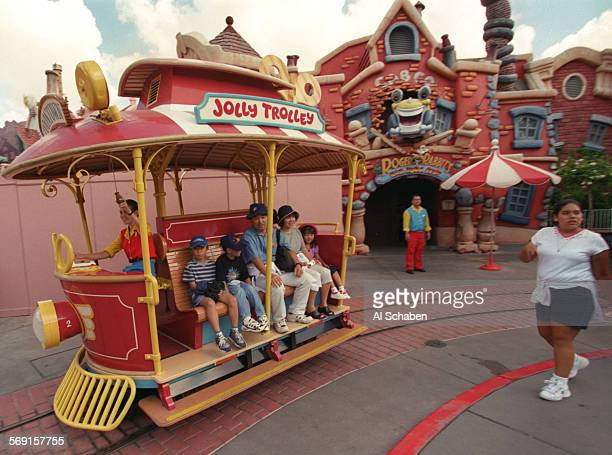 Disneyland employee, center, turns away visiters from the closed Roger Rabbit's Cartoon Spin ride in Toon Town Saturday after a four–year old boy was...